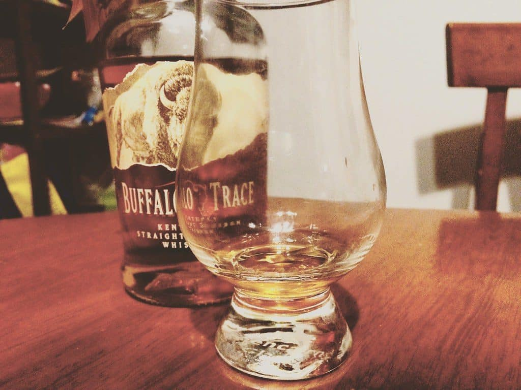 buffalo trace whiskey with glass